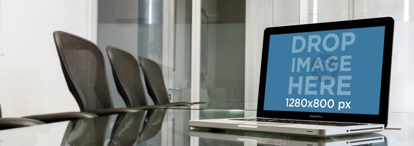 MacBook Pro Over Glass Desk In Business Room Wide